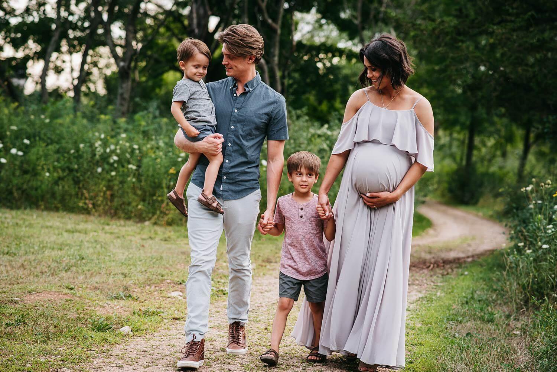 appleton maternity photographer family walking by daphodil photo